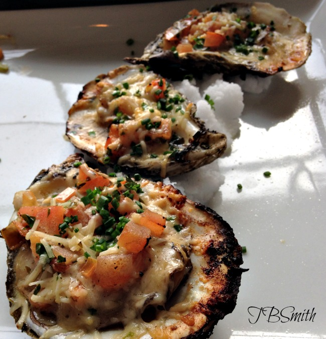 Grilled oysters are divine little treats.