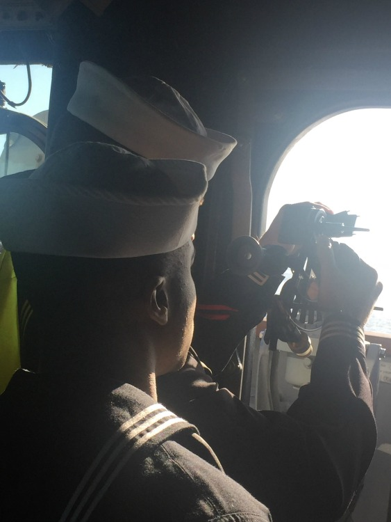 working the compass onboard the USS Leyte Gulf