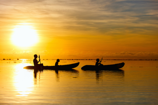 Kayak Fishing Family kayaking at sunset